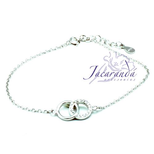 Pulsera cadena de plata centro dos círculos entrelazados, uno liso, otro circonitas, baño rodio