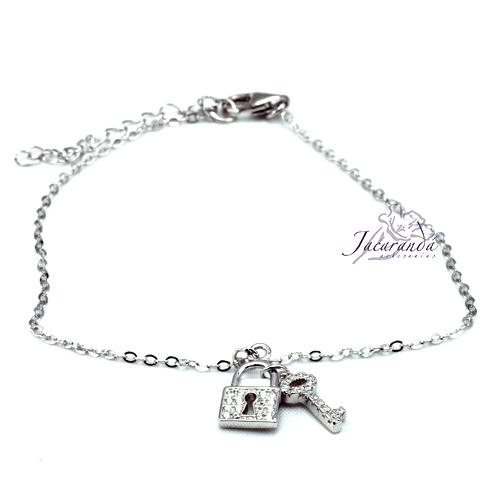 Pulsera cadena de plata centro candado y llave colgando con circonitas, baño rodio
